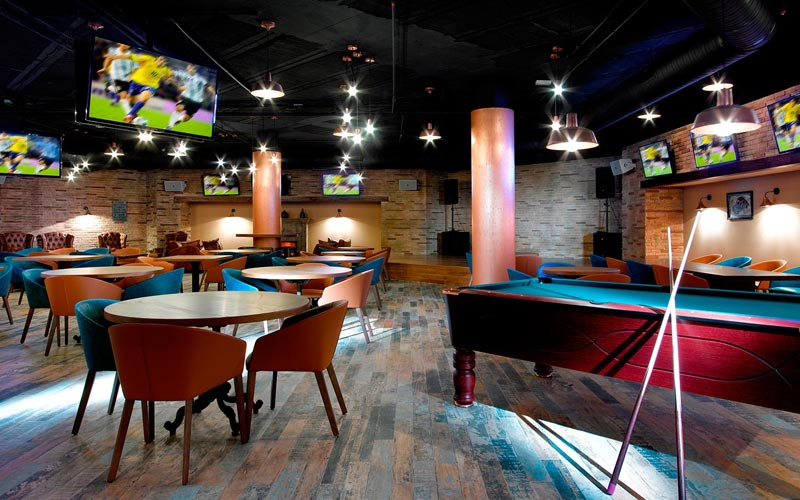 A seating area with pool tables