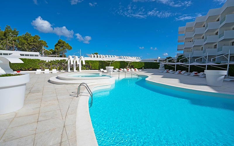 A large pool and the exterior of THB Naeco Ibiza