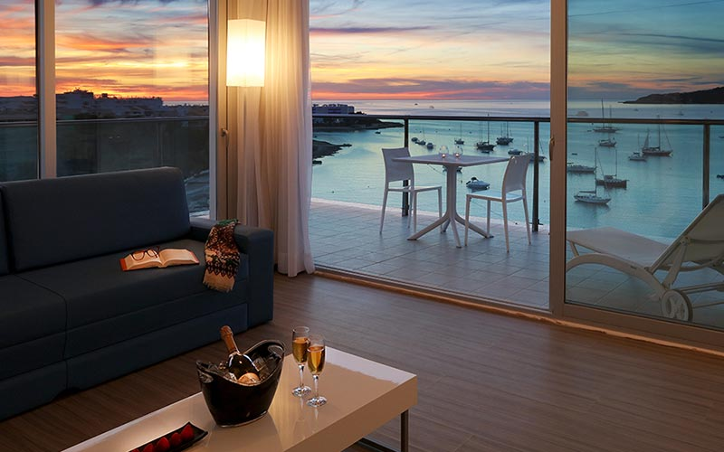 A suite at AxelBeach Ibiza with a view of the sunset