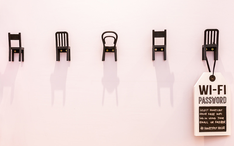 Five tiny chair wall decorations with a plaque hanging on one of them