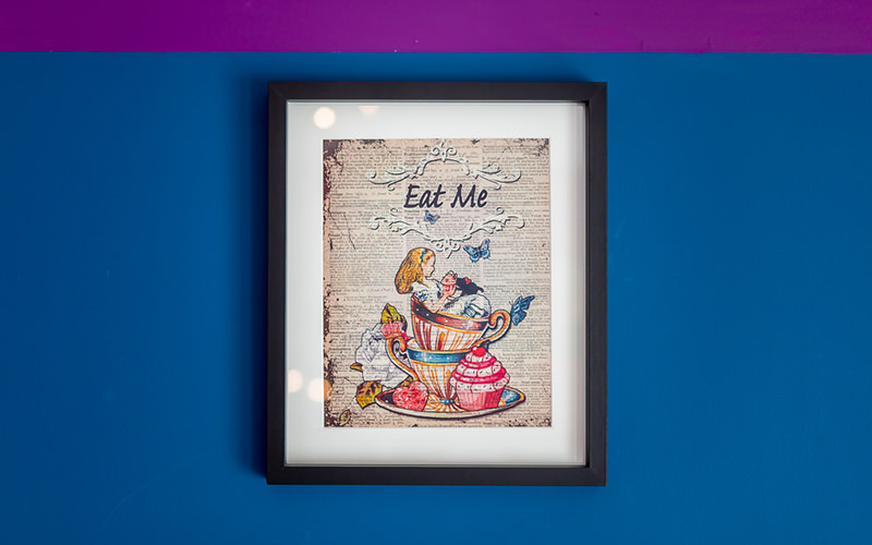 Wall art featuring illustrations from alice in wonderland