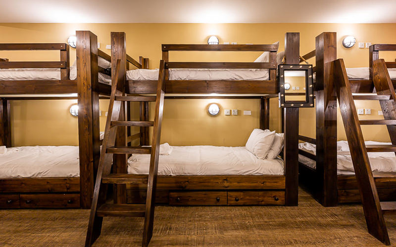 A close up view of wooden bunk beds