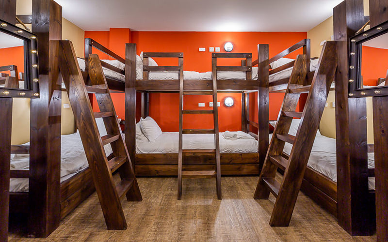 A view of wooden bunk beds with ladders