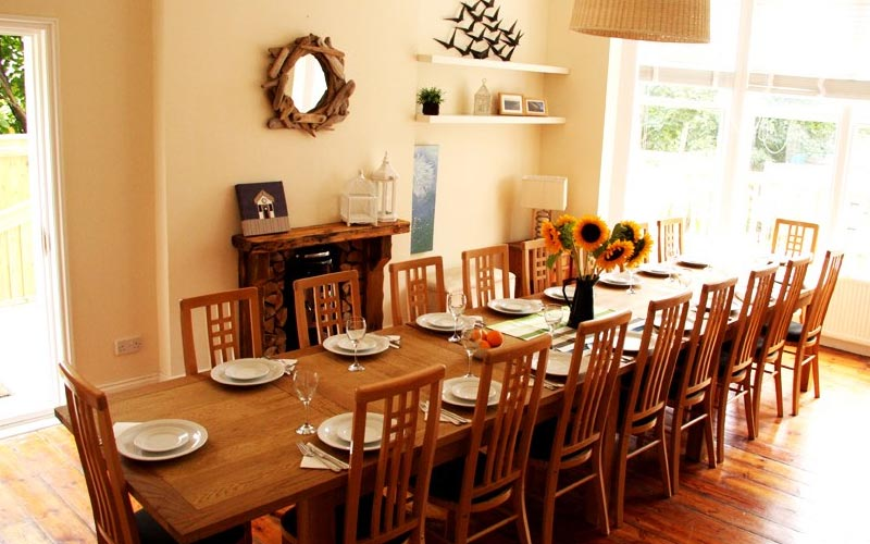 A kitchen with a large table and chairs