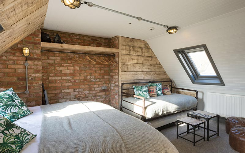 A guest room at One Broad Street with brick walls