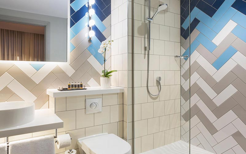 A tiled bathroom at Hotel Indigo Cardiff