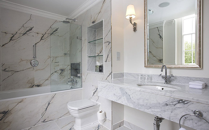 A marble bathroom in Bailbrook House Hotel