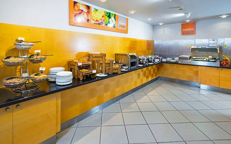 The breakfast buffet area in the Holiday Inn Express