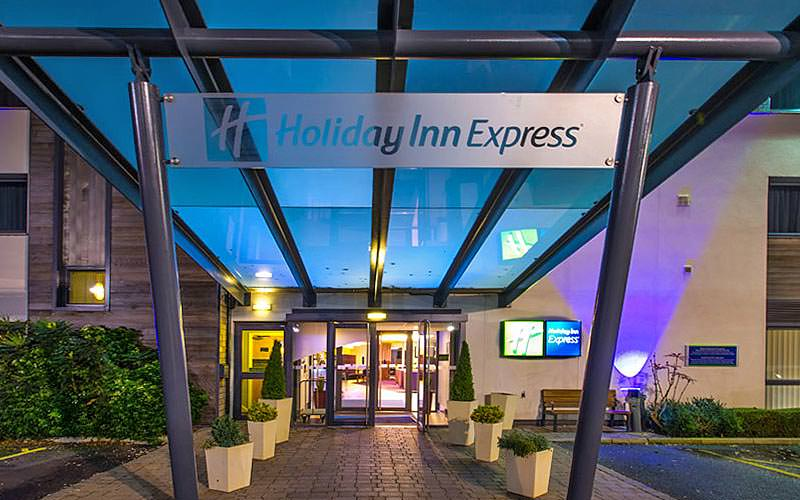The exterior sign for the Holiday Inn Express