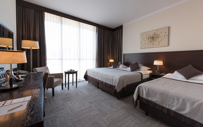 A hotel room with two double beds