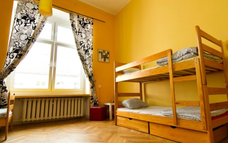 A hostel room with a bunk bed