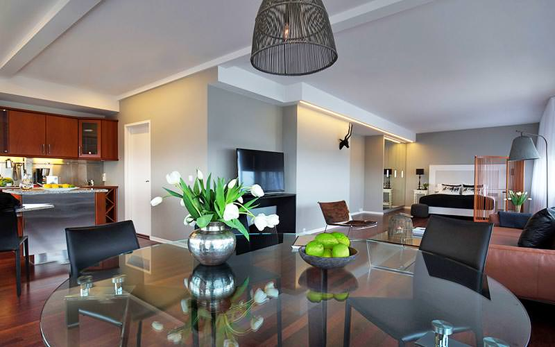 A large open plan apartment with a large double bed and modern kitchen