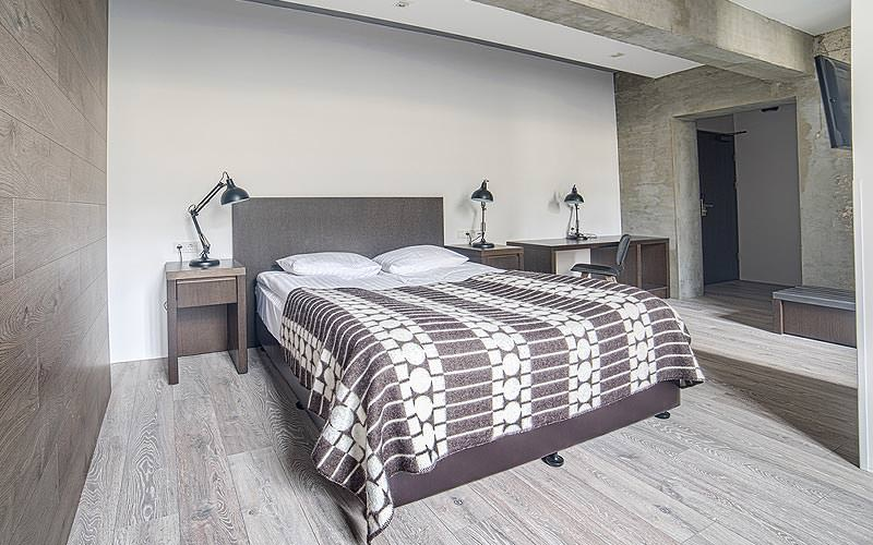 A double bed in a large, Scandinavian-designed guest room