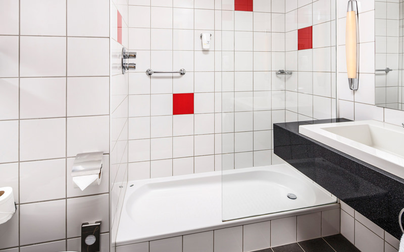 A tiled bathroom in a hotel room