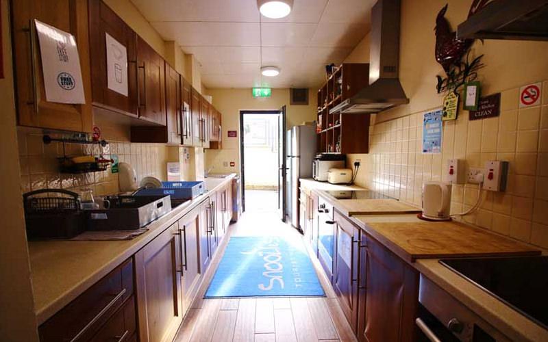 A kitchen layout in a hostel