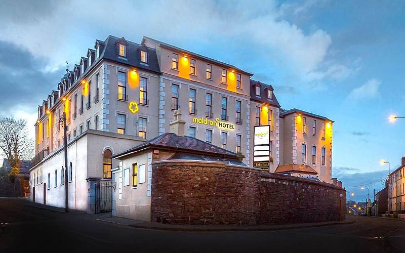 Exterior of the Maldron Hotel, Cork, lit up at sunset
