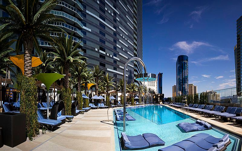 An outdoor swimming pool at the base of the Cosmopolitan