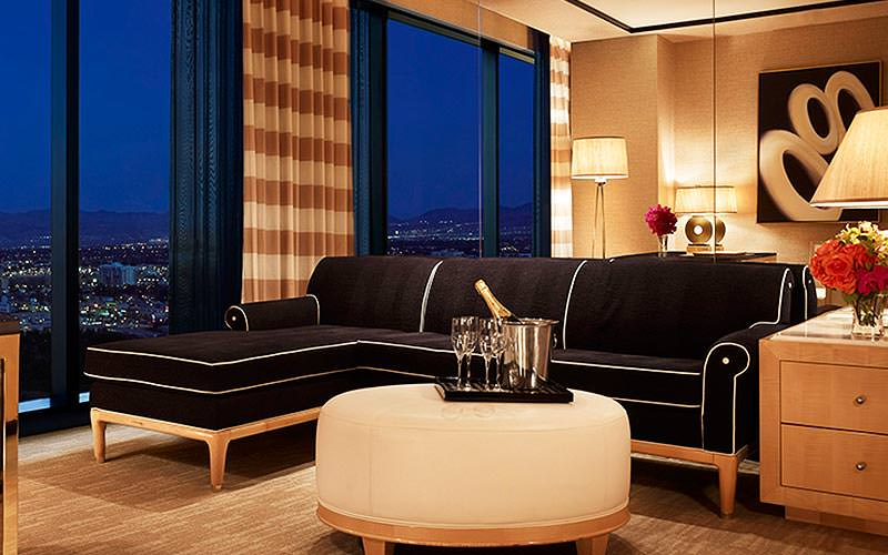 A black corner sofa in a large room at the Encore Hotel