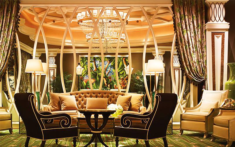 An ornate lounge area next to a mirrored wall