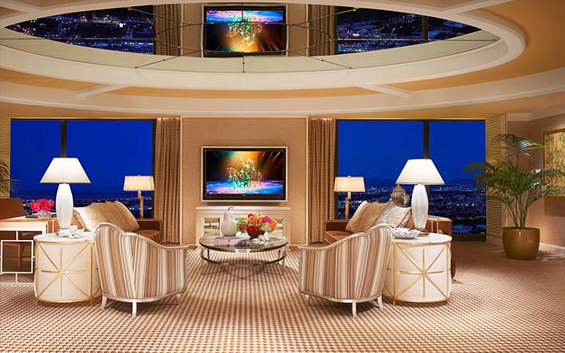 A large, open lounge area with floor-to-ceiling windows at the Wynn Hotel