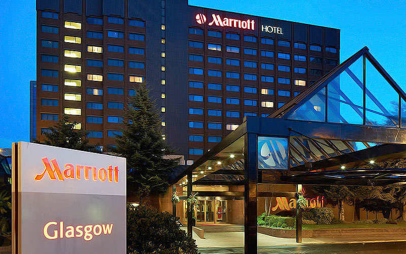 Exterior building, entrance and sign of the Marriott Glasgow at night