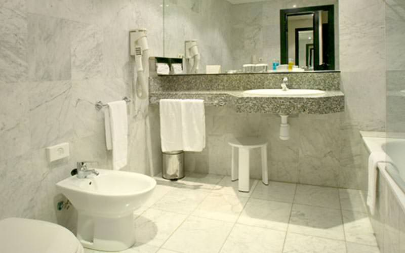 A grey tiled bathroom