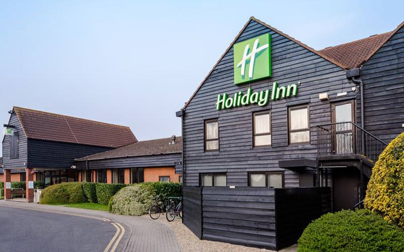The wooden exterior of the Holiday Inn Cambridge during the day