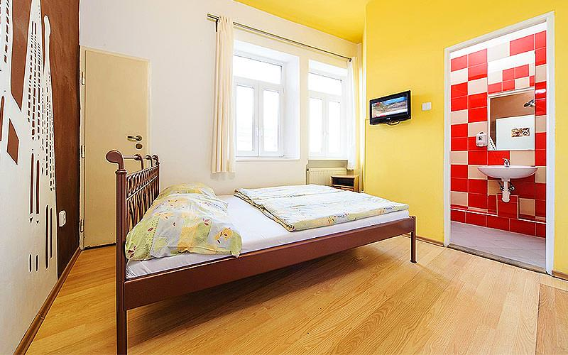 An example guestroom at Hostel Blues with yellow walls