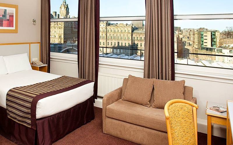 A double room with a picturesque view of Edinburgh out of the window