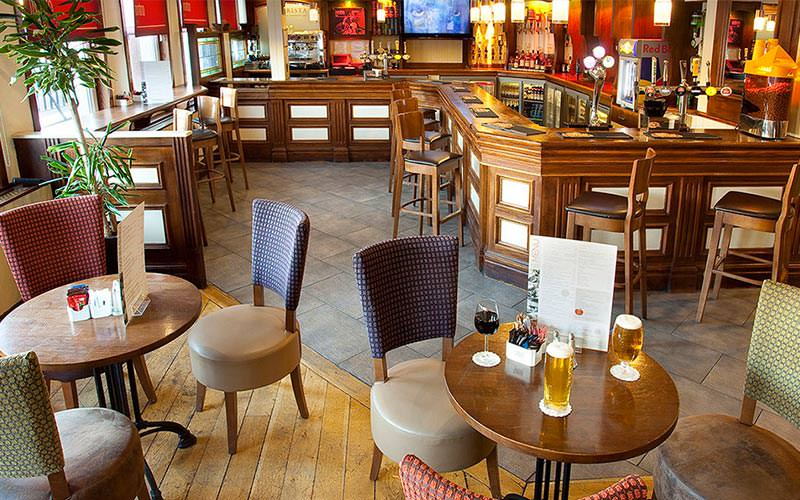 The bar area with tables, and a round of drinks on the table