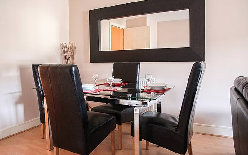 A dining table set for four in an apartment