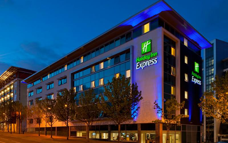 The exterior of the Holiday inn Express at dusk