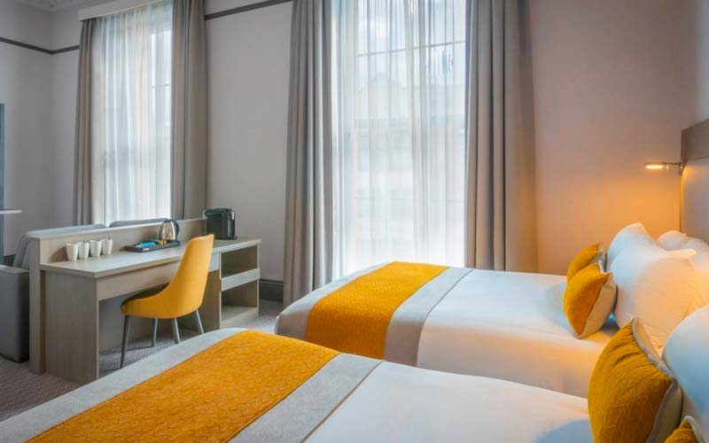 A guest room with a large double bed at the Maldron Hotel Parnell Square