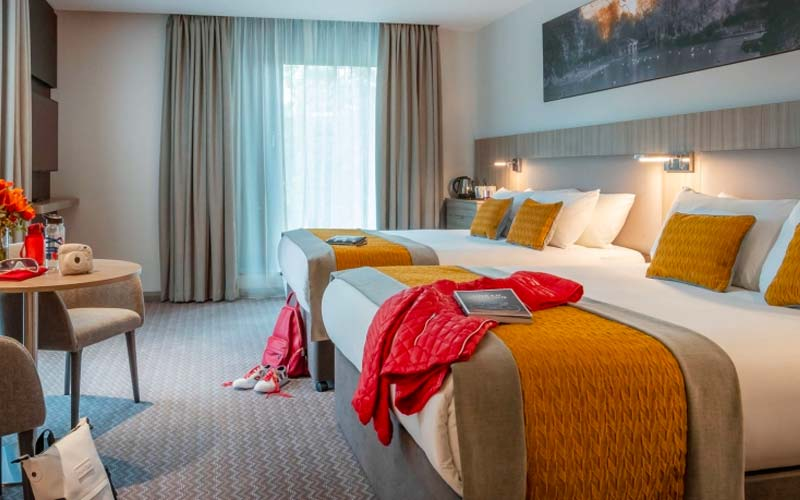 A guest room with three twin beds at the  Maldron Hotel Parnell Square