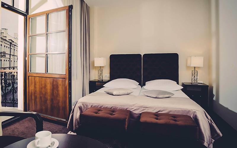 A twin guest bedroom and open balcony door