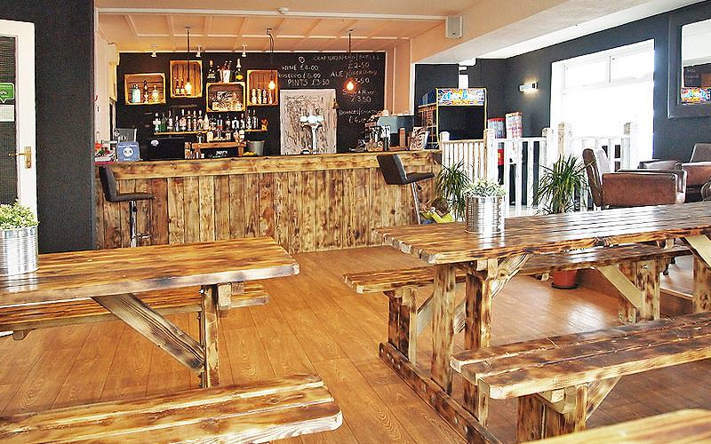A bar with wooden furniture inside