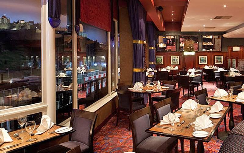 Dark red restaurant at the Mercure Edinburgh Princes Street Hotel