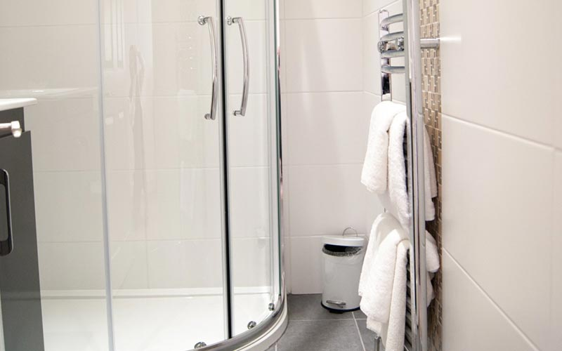 A shower room area with white towels