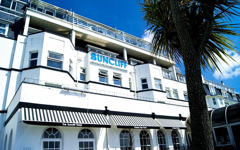 The whitewashed exterior of Suncliff Hotel