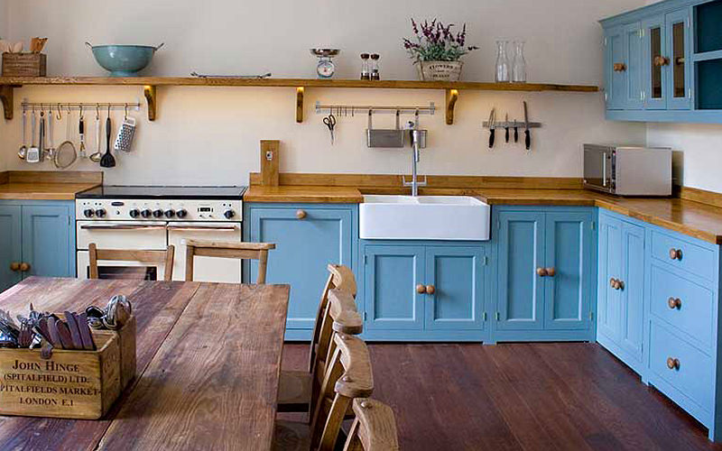 A rustic kitchen area in Bath Town House 14, with blue cupboards and drawers