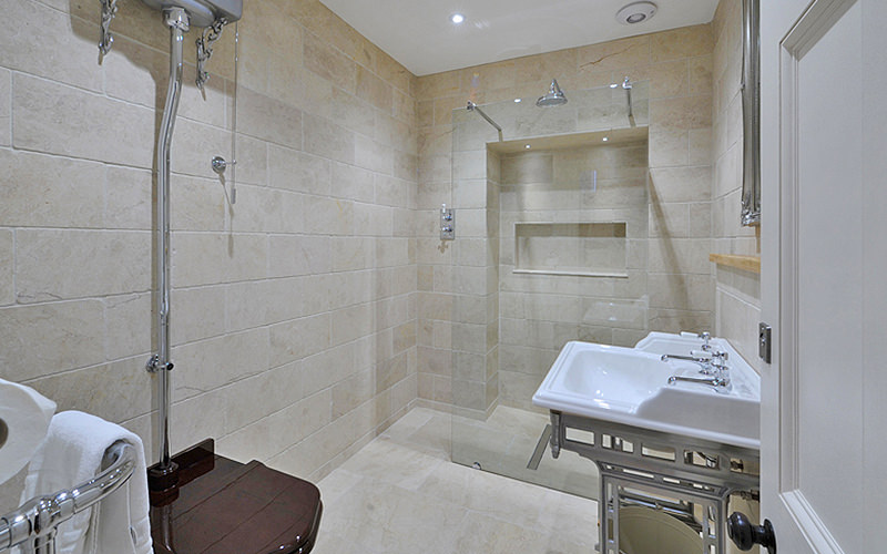 A shower room completely tiled