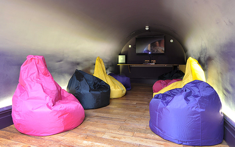 A cinema room with beanbag seats
