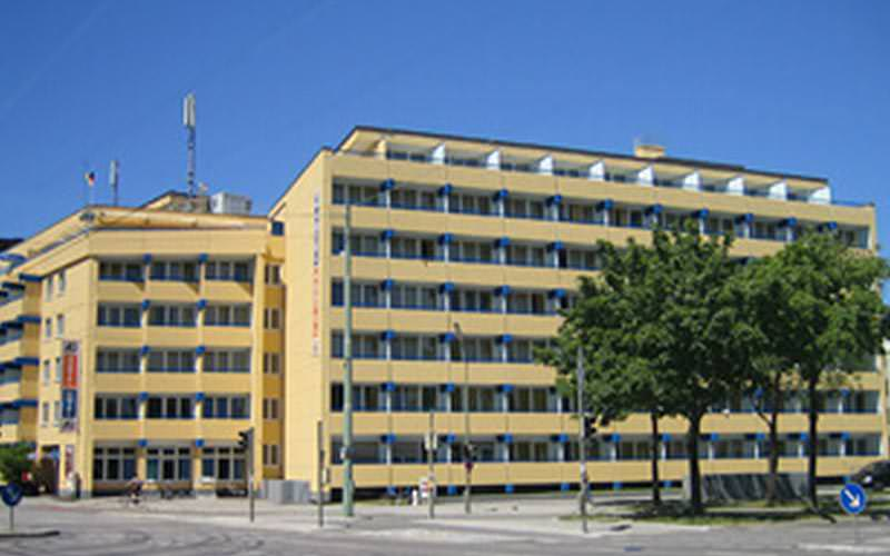 The exterior of A&O Hackerbruke, under a blue sky