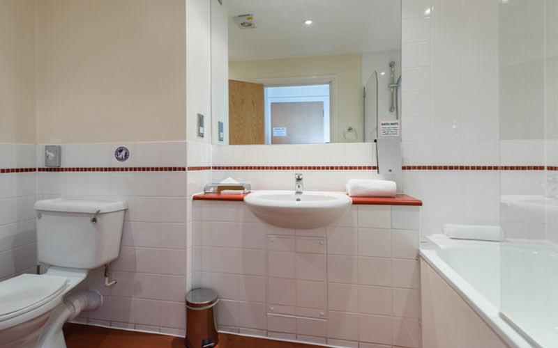 A white tiled bathroom