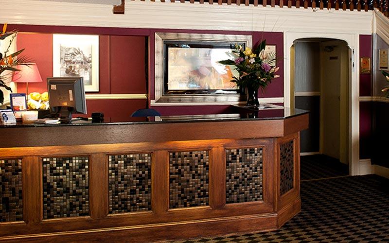 The reception desk at Hallmark Chester Inn