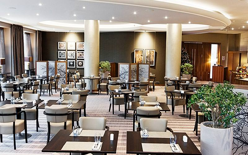 A dining and lounge area at Hilton Sofia