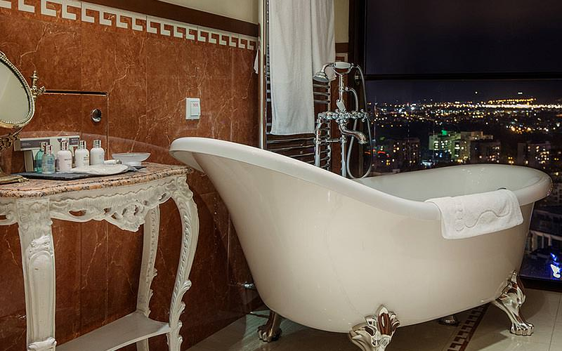 A bathroom with expansive views over Sofia