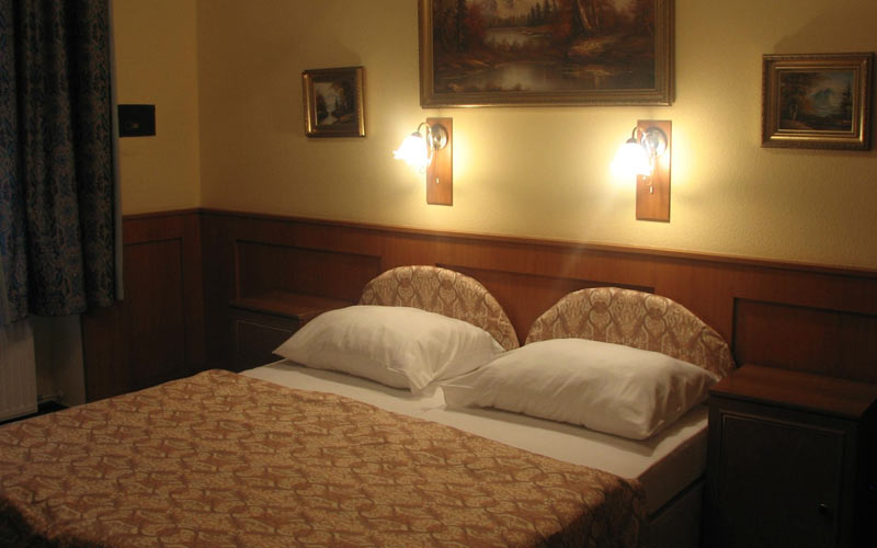 Two single beds in neutrally decorated room