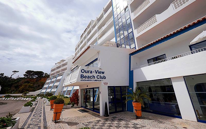 Exterior entrance of Oura View Beach Club during the day