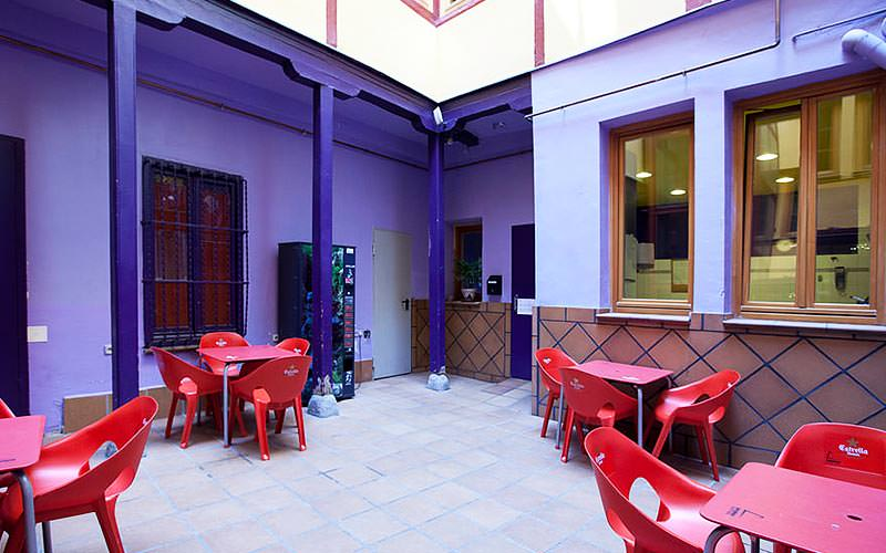 Red tables and chairs in a purple room
